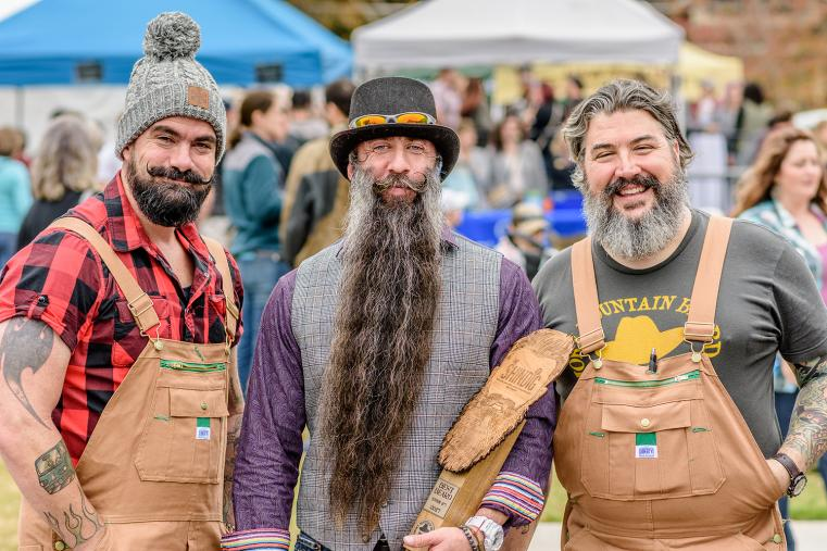 Three men with impressive beards pose side by side during the Clayton Shindig American Music Festival's beard competition