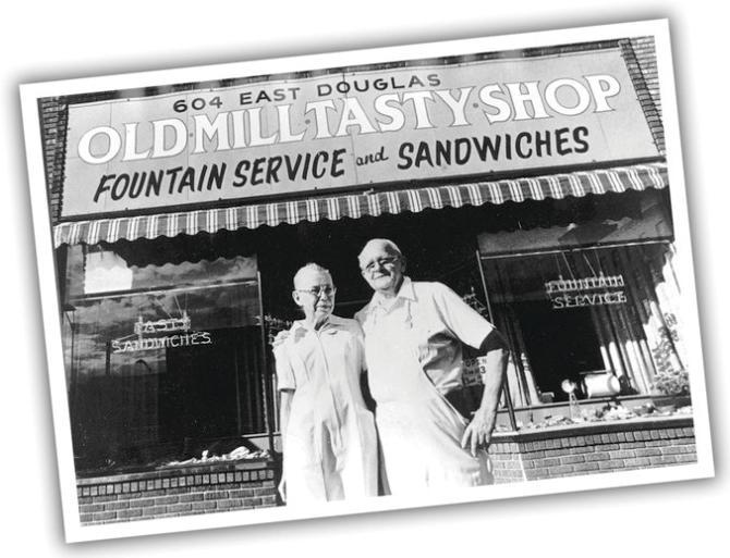 A black and white postcard shows the 2 original owners of Old Mill Tasty Shop standing in front of their restaurant in Wichita