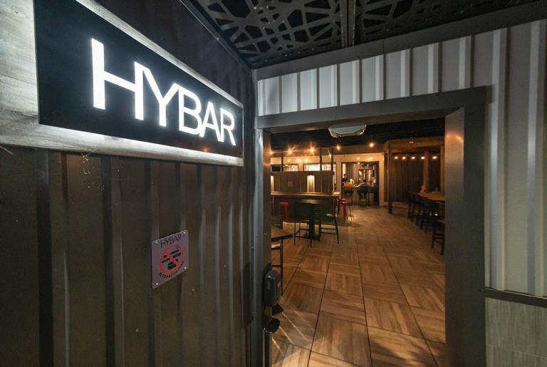 Hybar Athens sign rooftop