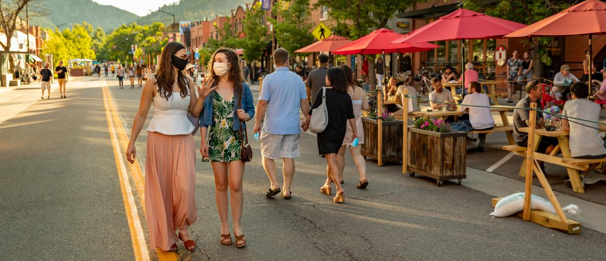Two women wearing masks walking in the Downtown Boulder Dining Street Closure