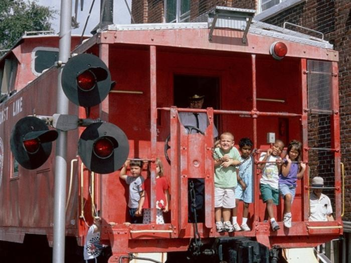 Kids on the caboose at the Railroad Museum in Wilmington NC