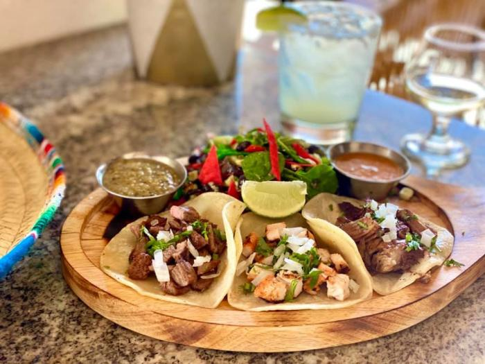 Try the tacos at Little Onion Restaurant while enjoying the weather in their outdoor dining area.