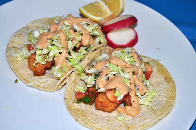 Mariscos La Costa fried shrimp tacos on a plate