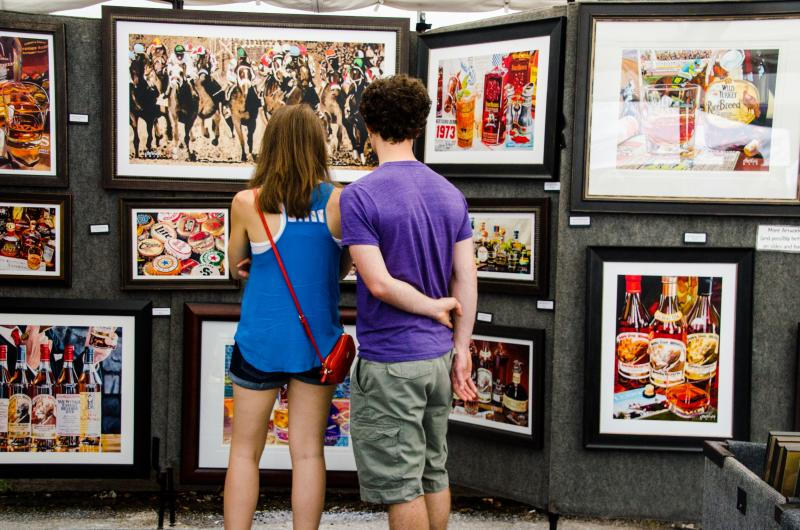 Couple Looking at Portrait at The Fourth Street Fest