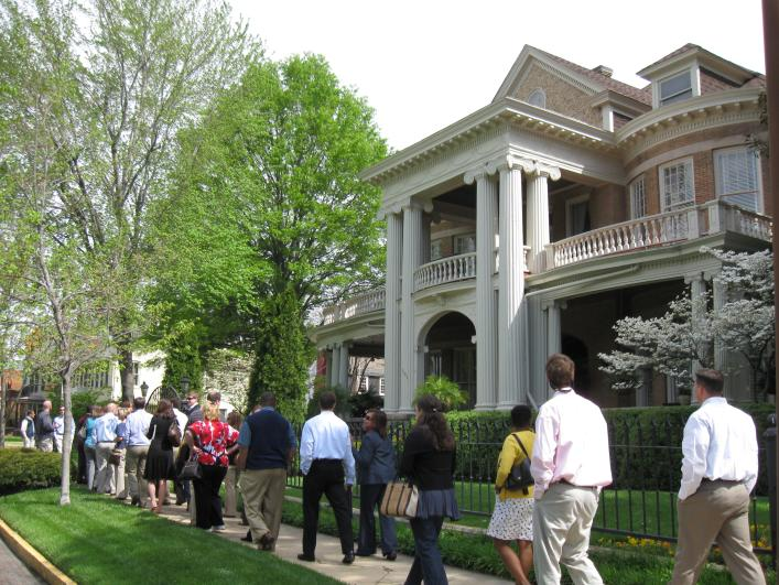 Visitors walk past historic homes in Huntsville, AL