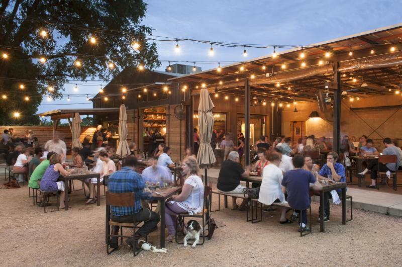 Contigo Beer Garden at twilight with twinkle lights