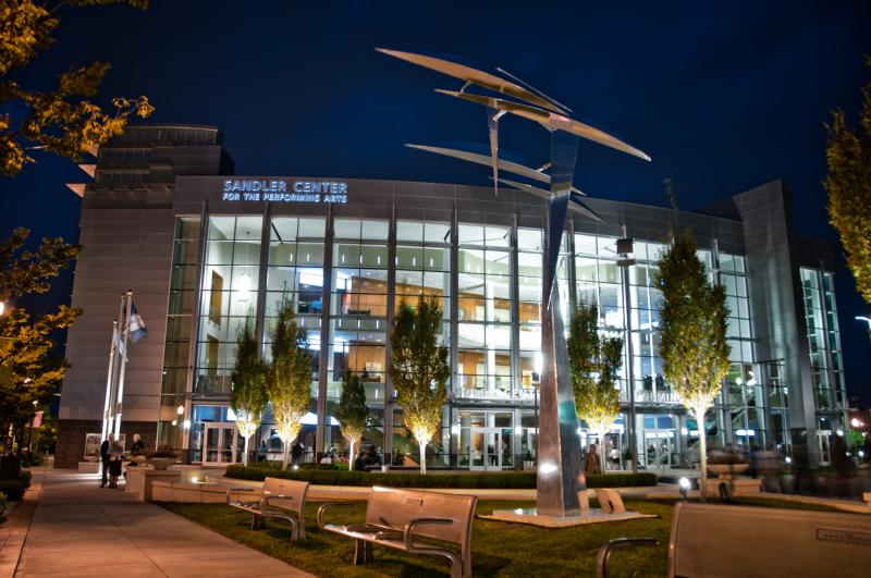 Sandler Center Plaza Wings Sculpture In Front Of The Building At Night