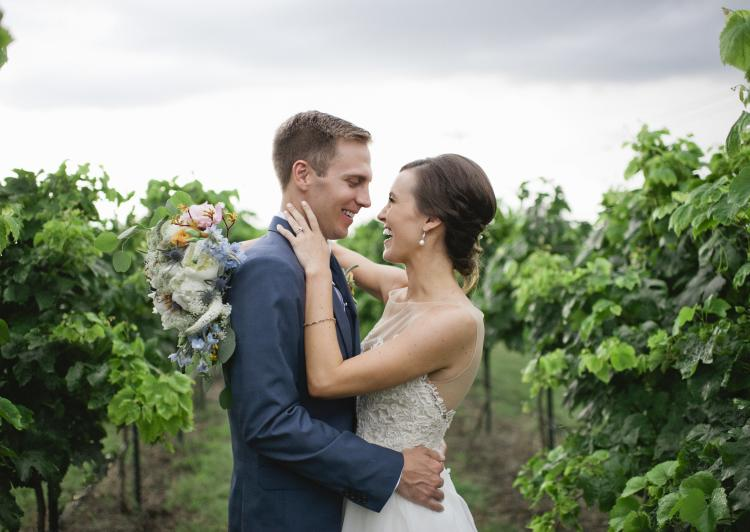Bride and Groom in the vineyard at 4.0 Cellars in Fredericksburg Texas