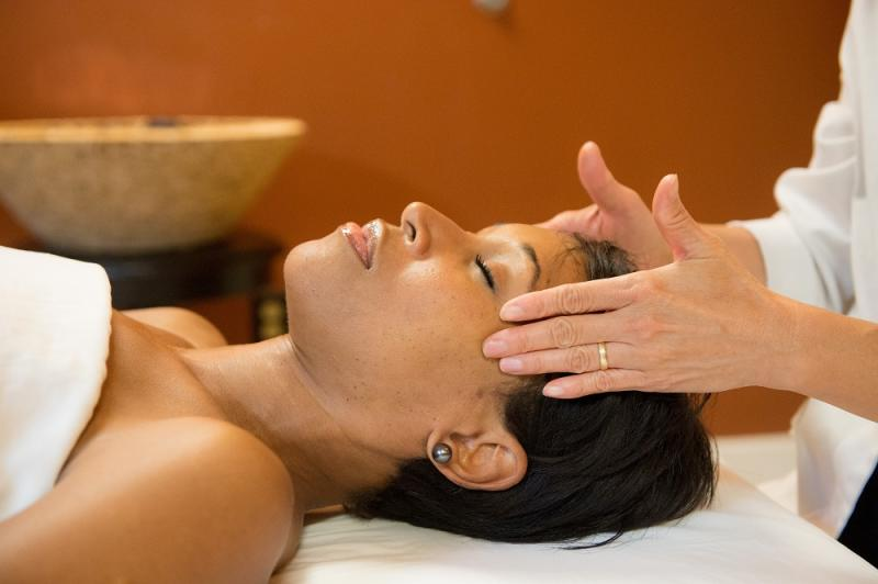 Picture of a women getting her head massaged at the Spa at Turf Valley