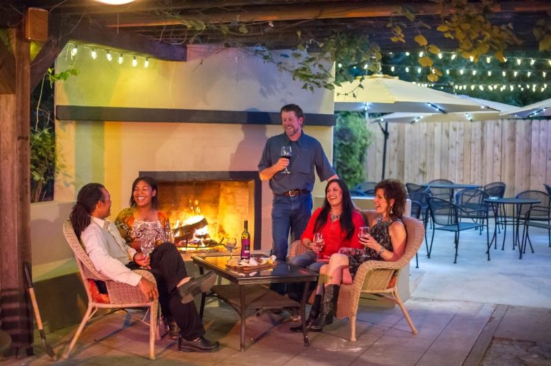 People drinking wine on the patio of Lincoln Street Wine Bar in Fredericksburg, TX