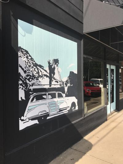 A mural picturing a car in Normaltown, Athens, GA.