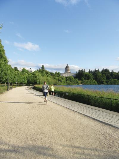 Visitors enjoy the paved pathway around Capitol Lake in Olympia.