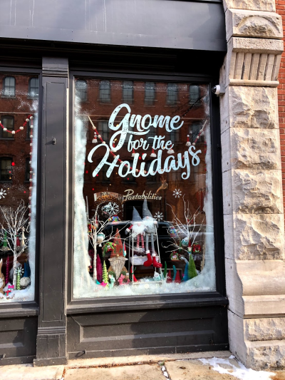 Pastabilities Restaurant Window decorated for the holidays to say Gnome for the Holidays