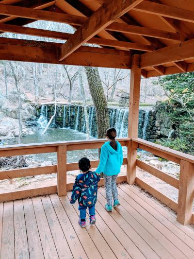 two children watching the waterfall over the dam at Cedarock Park