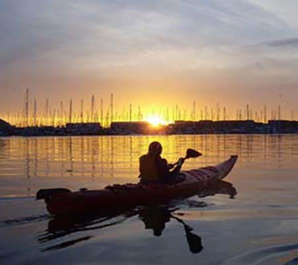 Kayaker Watching The Sunset