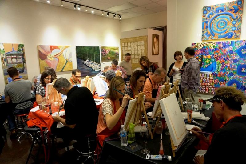 People painting at the Impastato Art Gallery in Louisiana