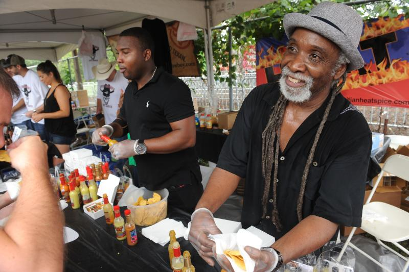 Man at Austin Chronicle Hot Sauce Fest serves sample