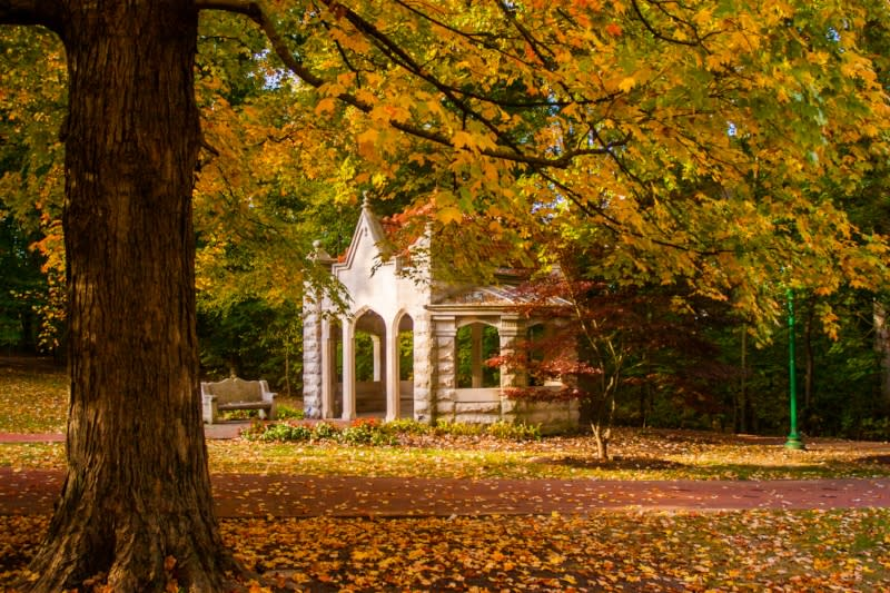 The Rose Well House at Indiana University surrounded by fall foliage