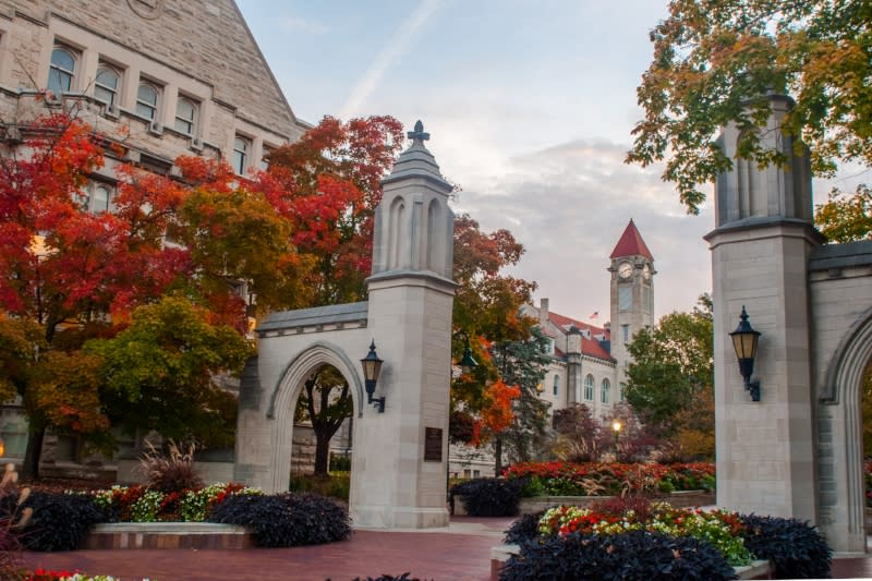 The Sample Gates at Indiana University surrounded by trees changing color