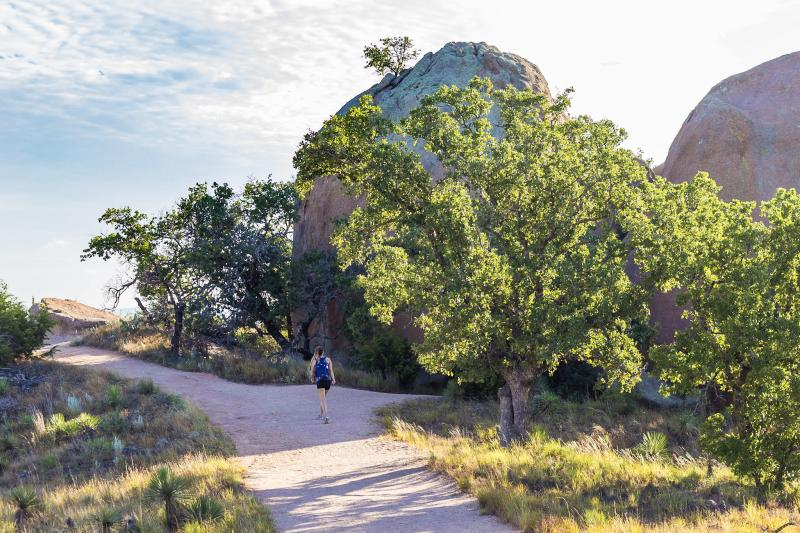 Woman on hiking trail at Enchanted Rock state park outside of Fredericksburg Texas