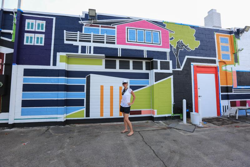 Artist Lisa Ashinoff (only female artist)Virginia Beach, VA(Mural is inspired by Ashinoff's signature architectural style of painting.)