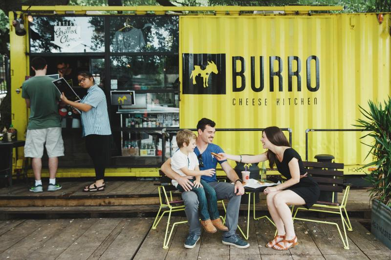 Couple with child outside of Burro Food Truck in Austin Texas