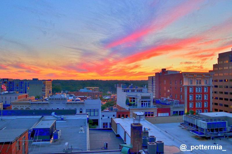Sun setting over skyline of Downtown Ann Arbor