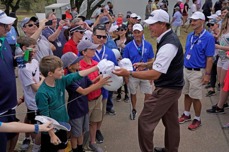 Phil Mickelson signs autographs at the Dell Match Play golf tournament in Austin texas