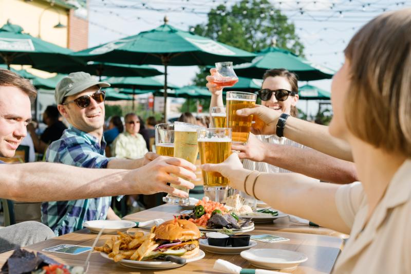 People drinking beer at Upland Patio in Bloomington