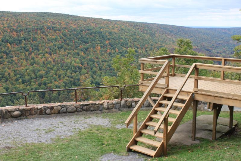 """View of Ontario County Parks' """"Jump Off"""", a scenic overlook with views of the surrounding landscape and homes in the distance."""
