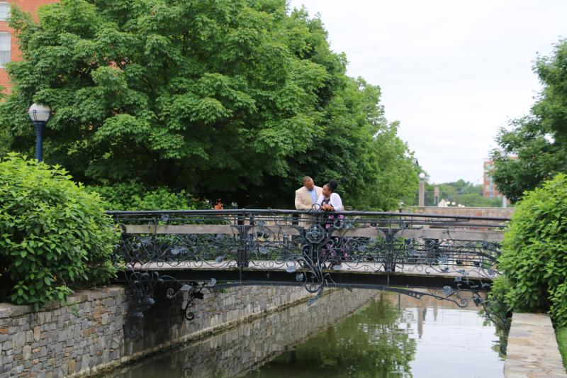 Couple standing on Carroll Creek Park Iron Bridge