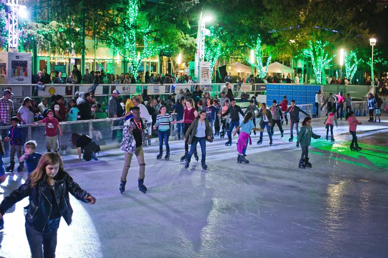 Evening ice skating on The Ice at Discovery Green during Frostival