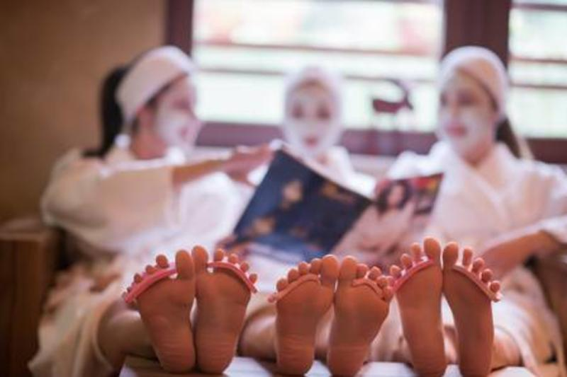 73377587-group-of-famale-friends-in-spa-have-fun-celebrate-bachelorette-party-with-face-mask
