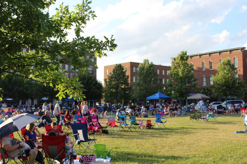 Visitors bring lawn chairs to an outdoor concert in Providence Park in Huntsville, AL
