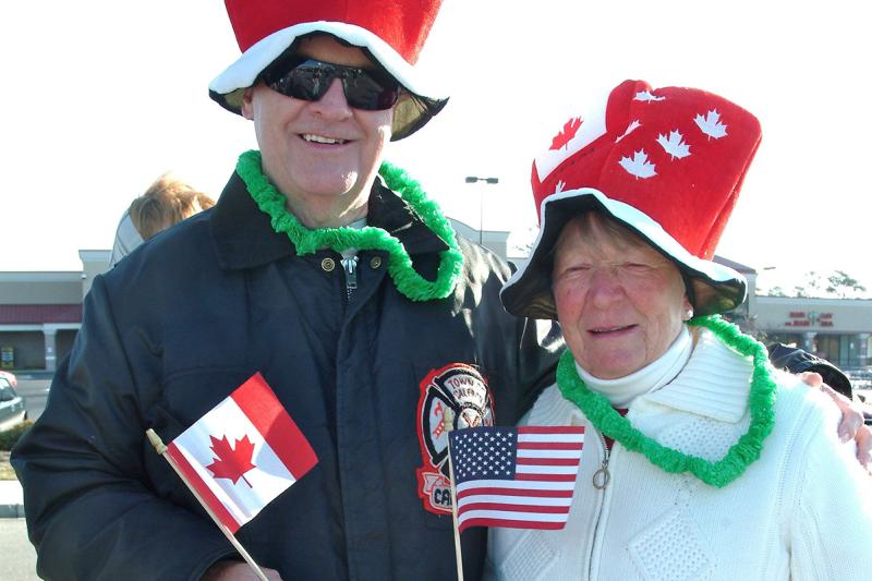 Canadian American Days couple with Canadian and American Flags