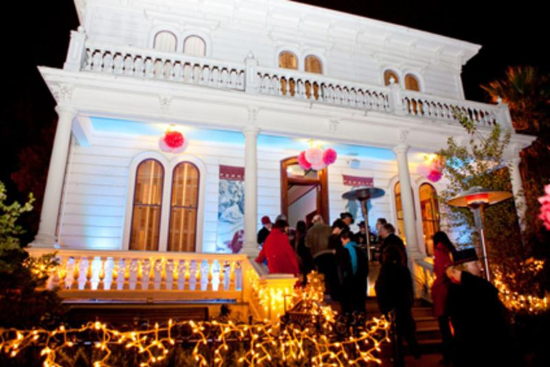 Image of Peralta House lit up during the holidays