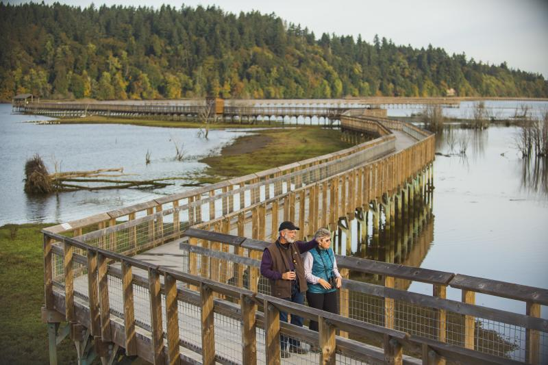 Visitors walk the expanse of boardwalk at the Billy Frank Jr. Nisqually National Wildlife Refuge.