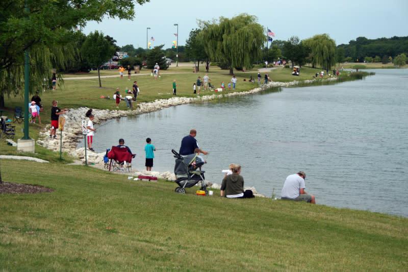 Lake Andrea People Fishing Along Shore