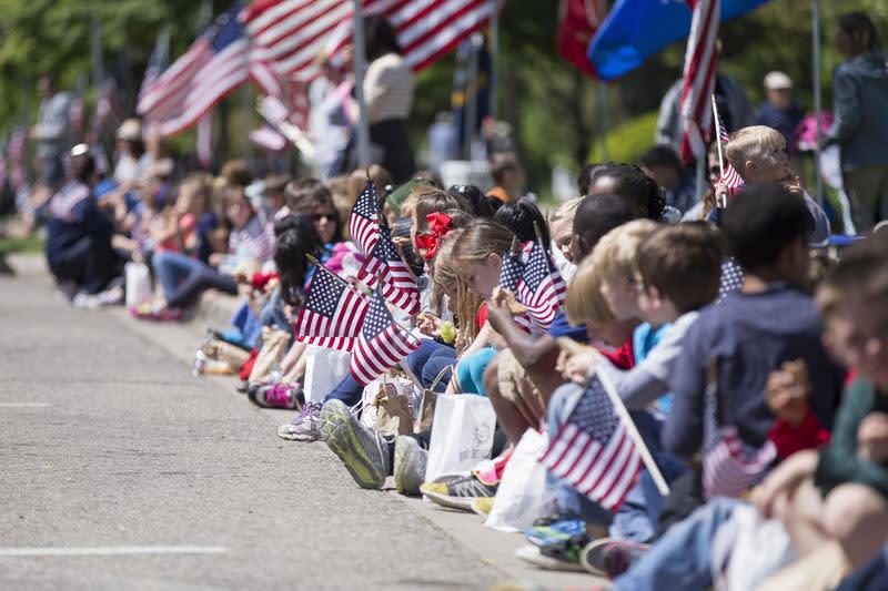 Memorial Day parade kids waving flags