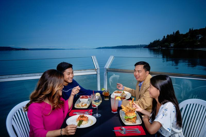 Family of four dining on the deck overlooking Puget Sound at Salty's Redondo Beach