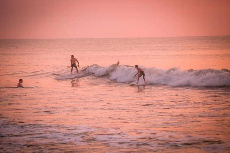 4 people out for a morning surf session at Croatan Beach