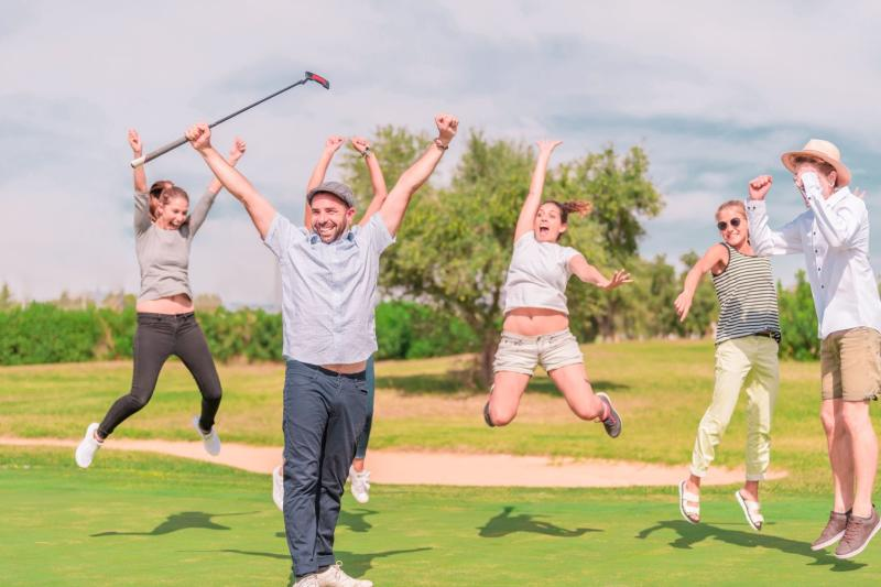A group of friends jump for joy during a fun round of golf in Irving.