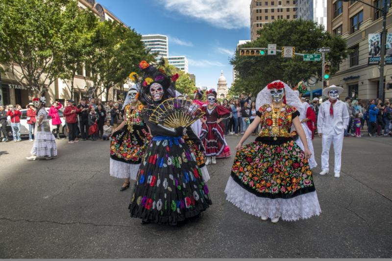 Viva la Vida Parade down congress avenue with women in dia de los muertos costume