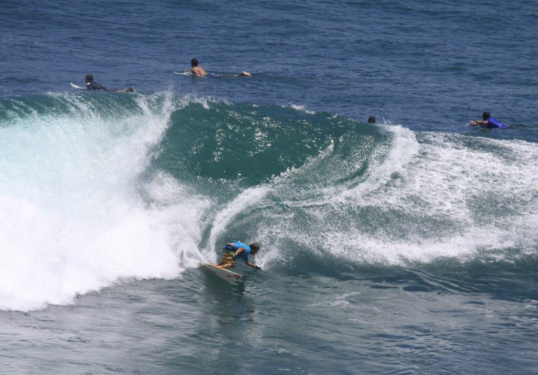 group surfing in water