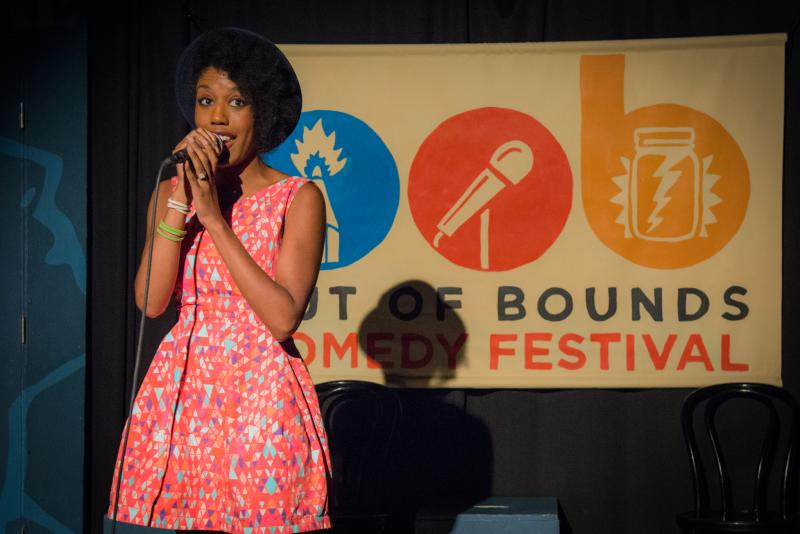 Comedian Nathalie Holmes performing at Out of Bounds Comedy Fest in Austin Texas