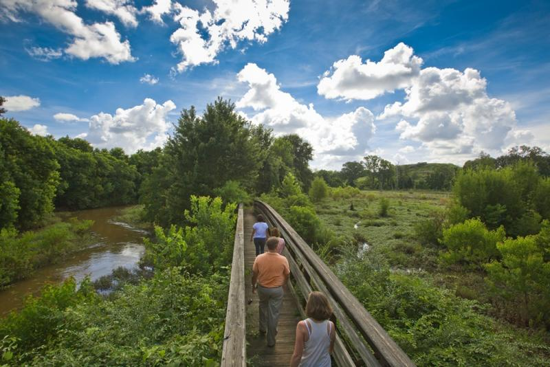 Crossing a footbridge in the Ocmulgee Wetlands near Macon, GA