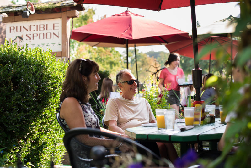 People sitting on patio at Runcible Spoon in Bloomington
