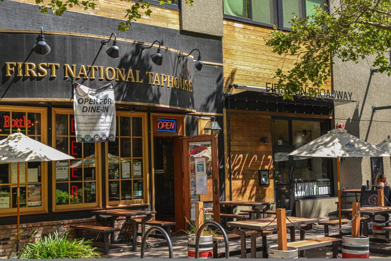 First National Taphouse shady outdoor seating with doors open for the public. Photo by Melanie Griffin