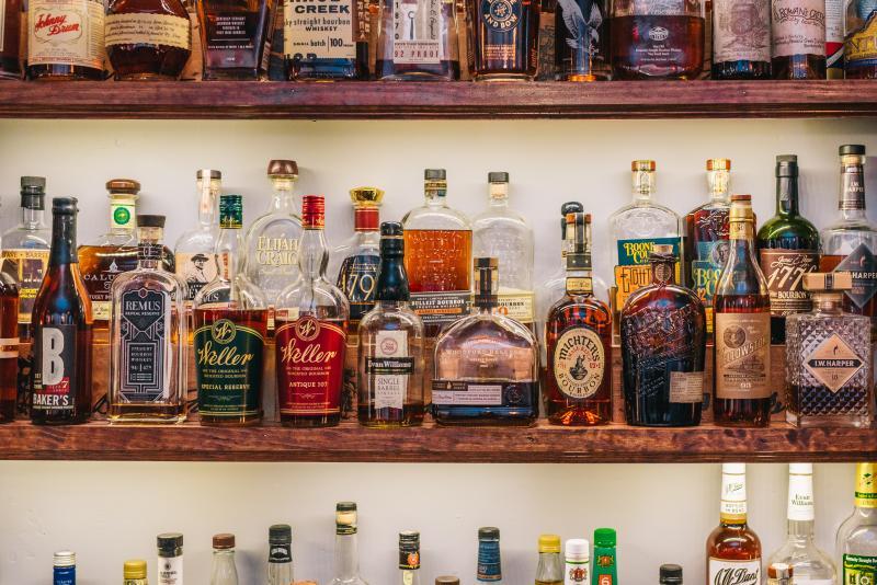 bourbon bottles on bar shelf