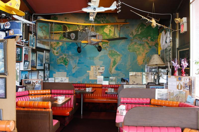 Interior of restaurant with colorful booths and airplane decoration